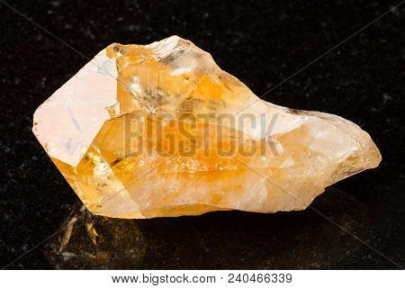 Macro Shooting Of Natural Rock Specimen - Crystal Of Citrine (yellow Quartz) Gemstone On Black Grani