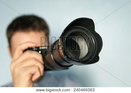 Young Photographer On Blue Background