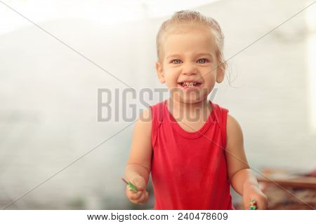 Portrait Of Adorable Little Caucasian Girl Of Two Year Showing Front Teeth With Big Smile, Healthy H