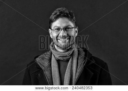 Happy Man In Glasses On Bearded Face. Bearded Man In Scarf And Coat On Dark Background. Fashion Mode