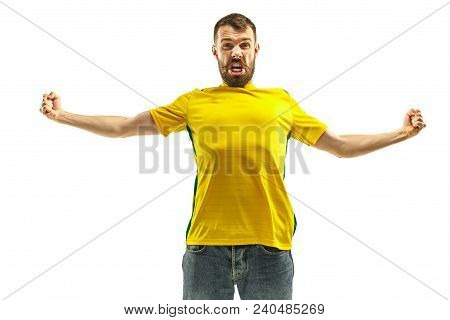 Brazilian Fan Celebrating On White Background. The Young Man In Soccer Football Uniform As Winner Is