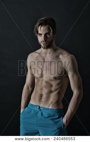 Sportsman With Sexy Torso And Chest. Man With Six Pack And Ab Muscles. Training And Workout Activity