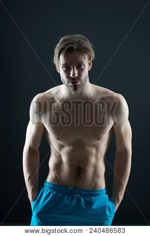 Sport Or Fitness And Bodycare Concept. Athlete With Fit Body In Shorts. Man With Six Pack And Ab Mus