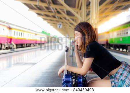 Portrait Charming Beautiful Traveler Woman. Beautiful Woman Looks At Copy Space. Pretty Girl Acts Li