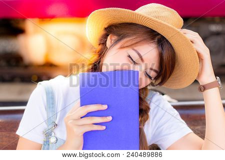 Beautiful Asian Woman Is Laughing The Story In Pocket Book That Make Her Feeling Relaxed, Happy, Rel
