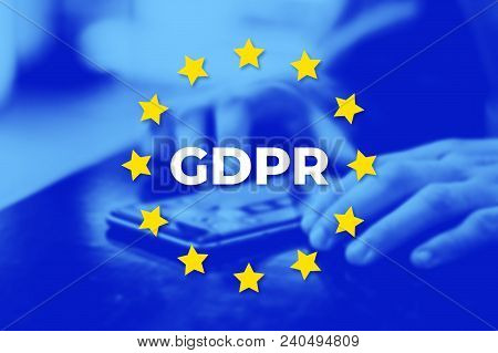 Gdpr - General Data Protection Regulation. Eu Flag With Blue Photo Background. User Protects Their D