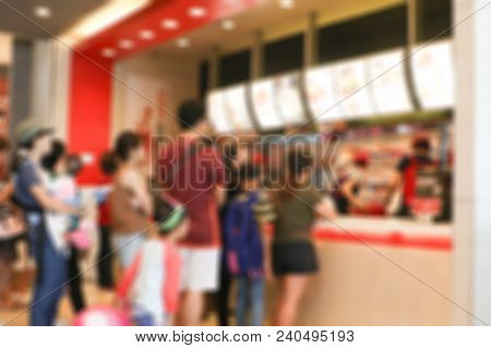 Blurred Fast Food Restaurant For Background.people In Urban Lifestyle Queue Up Waiting To Buy Food A