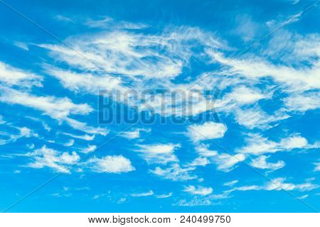 Beautiful Clouds On A Sunny Blue Sky. Heavenly Background. Universal Template For Background Inserti