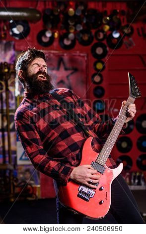 Rock Star Concept. Young Rock Musician, Singer, Talented Artist. Musician With Beard Play Electric G