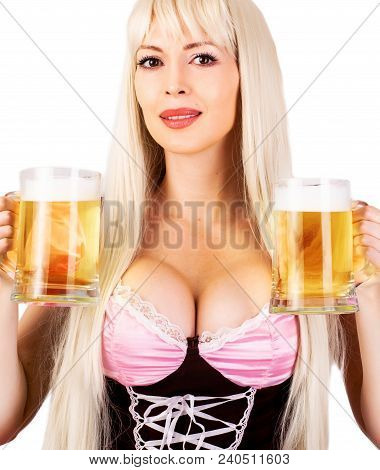 Young Beautiful Blond Oktoberfest Woman With Big Neckline On Female Breast Holds Two Mugs With Light