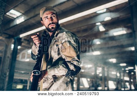 Nice And Confident Fighter Is Standing And Looking Right. He Has Rifle. Also Guy Is Holding Portable