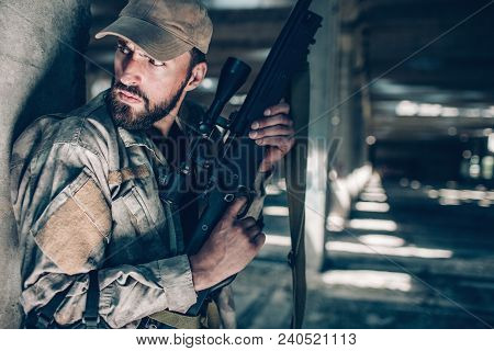Careful And Courageous Man Is Sitting Very Close To Column And Holding Rifle With Both Hands. Also H