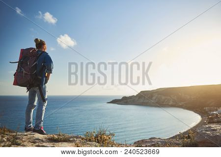 Low Angle Of Girl Being In Camping Trip. She Is Standing With Her Back On Mountain And Eyeing Beauti