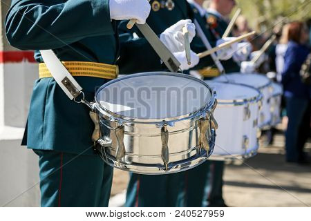 A Military Band Plays Drums In The Army. The Soldier In White Gloves Knocks On The Drum.