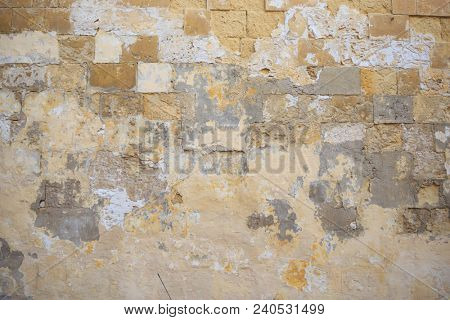 Limestone, sandstone brown, grey background. Weathered, peeled, vintage, empty wall for backdrop. Close up view with details.