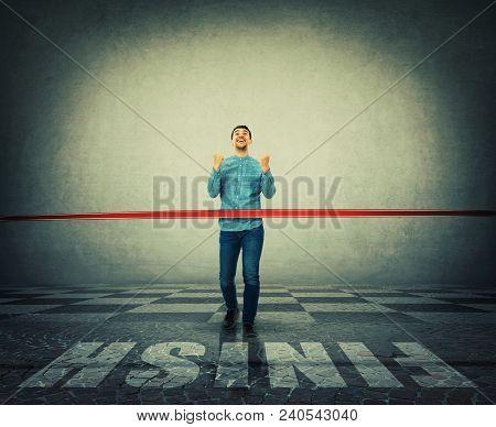 Winning Businessman Crosses The Finish Line, Breaking The Red Ribbon. Business Challenge Win, Motiva