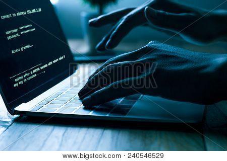 A Computer Programmer Or Hacker Prints A Code On A Laptop Keyboard To Break Into A Secret Organizati