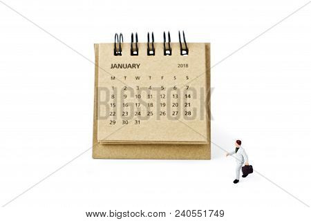 January. Meeting In January. Two Thousand Eighteen Year Calendar And Miniature Plastic Businessman O