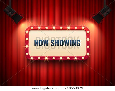Retro Cinema Or Theater Frame Illuminated By Spotlight. Now Showing Sign On Red Curtain Backdrop. Vi