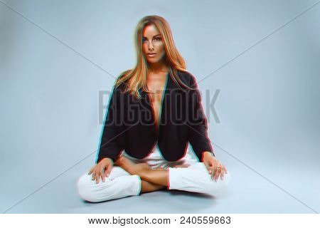Girl Model With Scandinavian Appearance In A Dark Jacket Over A Naked Body And White Pants Posing In