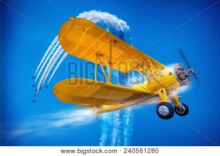 Yellow Sports Plane Against A Blue Sky