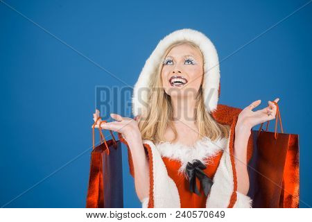 Christmas, Sale, Shopping, New Year, Holidays And People Concept - Smiling Beautiful Woman In Santa
