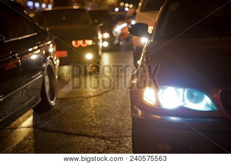 Night View Of The Cars. The Night With Yellow And Red Electrical Light For Cars During They Are Comi
