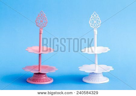 Pink And White Tier Serving Trays On Blue Background