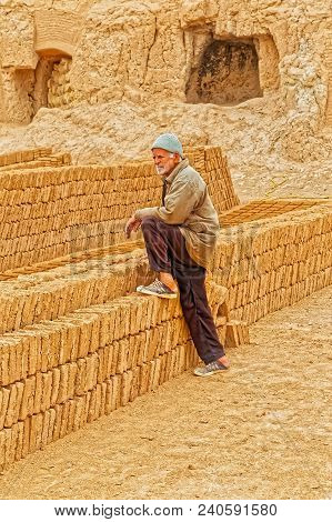 Meybod, Iran - May 6, 2015: Clayman Resting By The Clay Bricks At His Working Place In Iran.