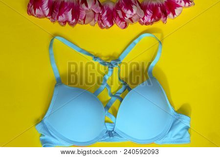 Blue Bra. Romantic Lingerie.textile, Underwear. Blue Bra Over Yellow Background. Fashion, Shopping,
