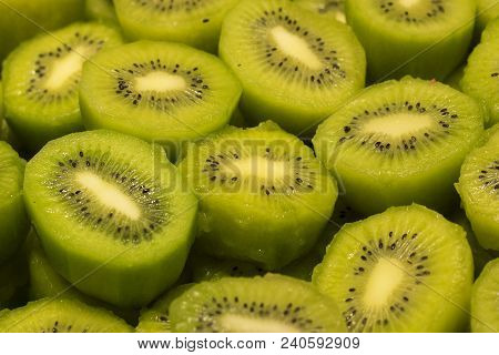 Fresh Kiwi Fruit As Background. Ripe Kiwi On The Food Market.