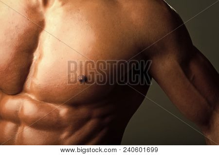 Athletic Bodybuilder Man On Black Background. Coach Sportsman With Bare Chest. Sport And Workout. Di