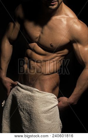 Athletic Bodybuilder Man On Black Background. Coach Sportsman With Bare Chest, Shower. Sport And Wor