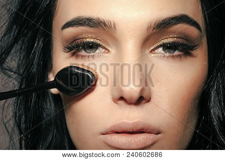 Foundation Make Up Brush Near Face Of Pretty Woman Or Cute Sexy Girl With Brunette Hair, Has Long Ey