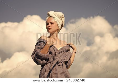 Model Sunbathing On Sunny Day. Spa And Wellness. Summer Vacation Concept. Woman In Bathrobe And Towe