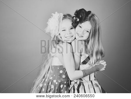 Little Girls In Fashionable Dress, Prom. Little Girls Sisters Embrace.