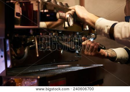Barista Cafe Making Coffee Preparation Service Concept. Professional Barista At Work In A Cafe Resta
