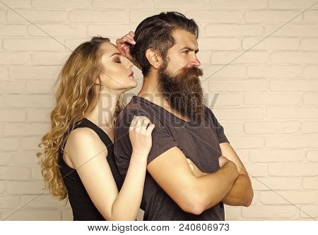 Couple In Love Hug On White Brick Wall. Man With Beard And Woman With Long Blond Hair. Hipsterism, S