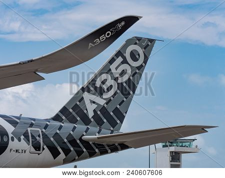 Singapore - February 4, 2018: Winglet And Tailplane Of Airbus A350-1000 Xwb In Airbus Factory Livery