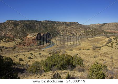 Mills Canyon With The Canadian River Winding Past A Prominent Rock Formation In Kiowa National Grass