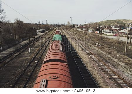 Freight cars at the railway station.  Wagons. Railway. Railway transport. Urban landscape. Outskirts. Grunge landscape.
