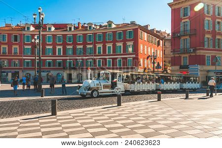 Nice, France - October 11, 2009: White Tourist Train Passing Through Historic Square Place Massena I