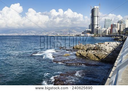 Beirut, Lebanon - September 29 2015: Seacoast With Natural Pool And Swimmers In Beirut With Cityview