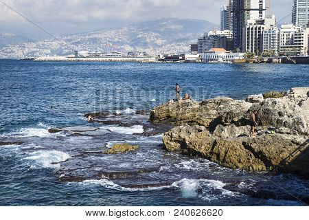 Beirut, Lebanon - September 29 2015: Detail Of Seacoast With Natural Pool And Swimmers In Beirut Wit