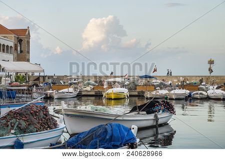 Tyre, Lebanon - October 7 2015: People And Army On The Wall Of The Fishing Harbour