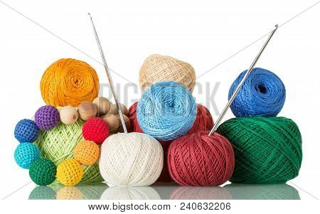 Original Beads Of Knitted Fabric, Tangle Of Yarn And Crochet Hooks Isolated On White Background