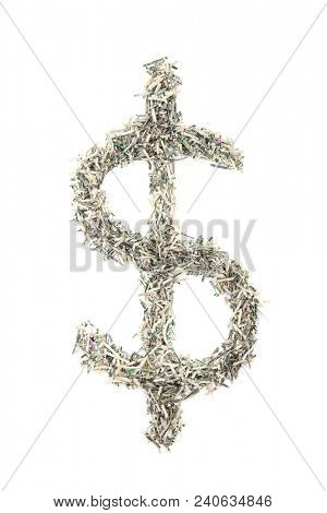 United States currency shredded in the shape of a dollar sign