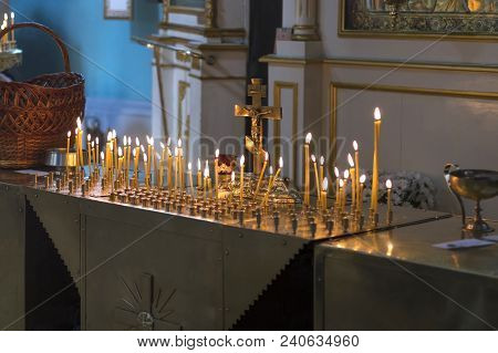 Burning Candles For The Peace Of The Soul Burn Before The Crucifix In The Twilight Of The Church