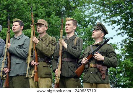 An unidentified member of Reibert history club wears historical pro - German UPA (Ukrainian Punishers Army) uniform during historical reenactment of WWII.May 7,2018. Kiev,Ukraine