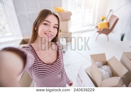 House-warming Selfie. Beautiful Young Woman Taking A Selfie Having Moved In To A New Flat And Wantin